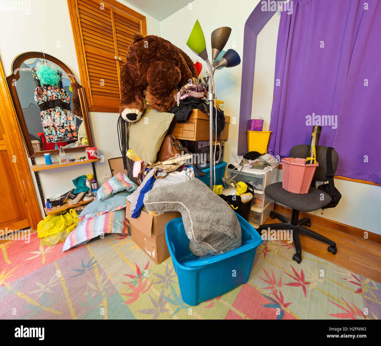 A cluttered college dorm room. - Stock Image