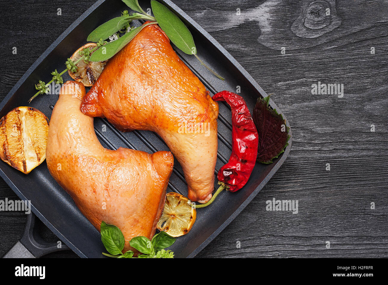 Smoked chicken legs with grilled vegetables top view with copy space Stock Photo