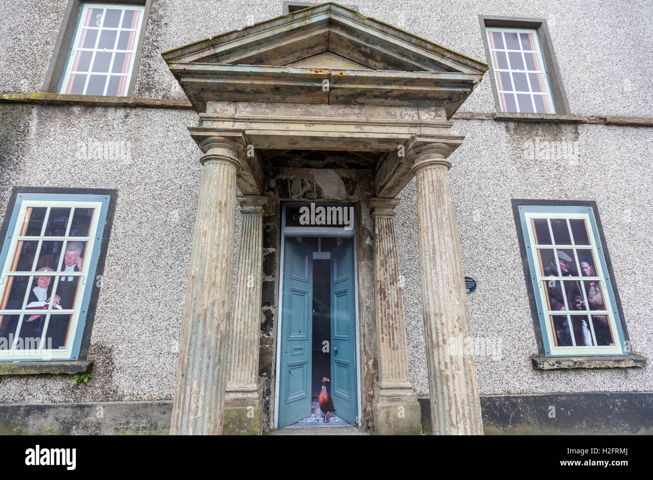 Bushmills house with painted window , County Antrim, Northern Ireland, UK - Stock Image