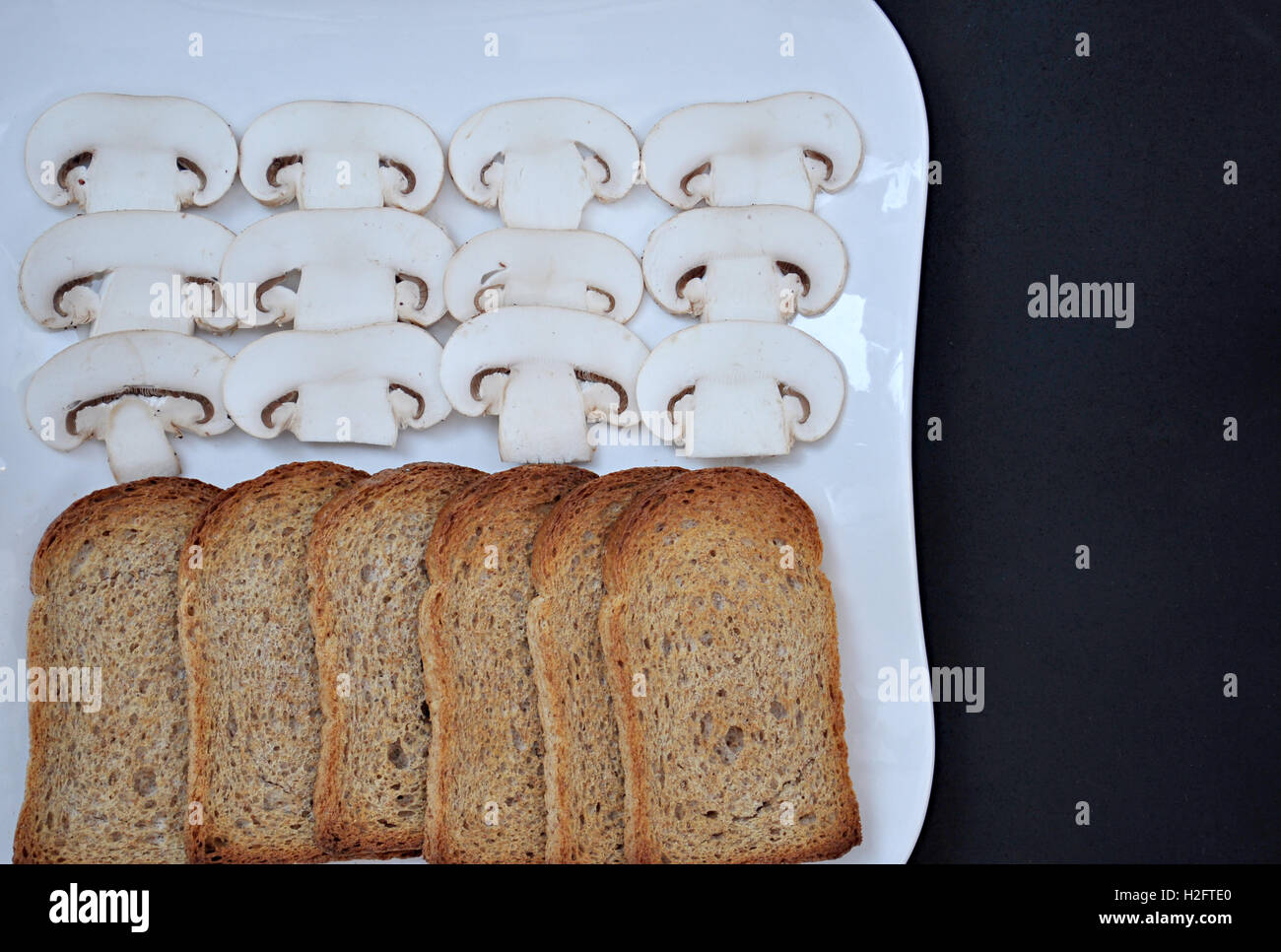 slices of bread and mushrooms - Stock Image