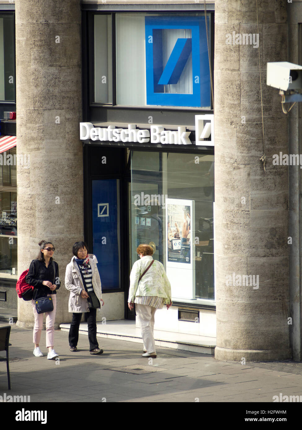 Deutsche bank office in Cologne, NRW, Germany, with people passing - Stock Image