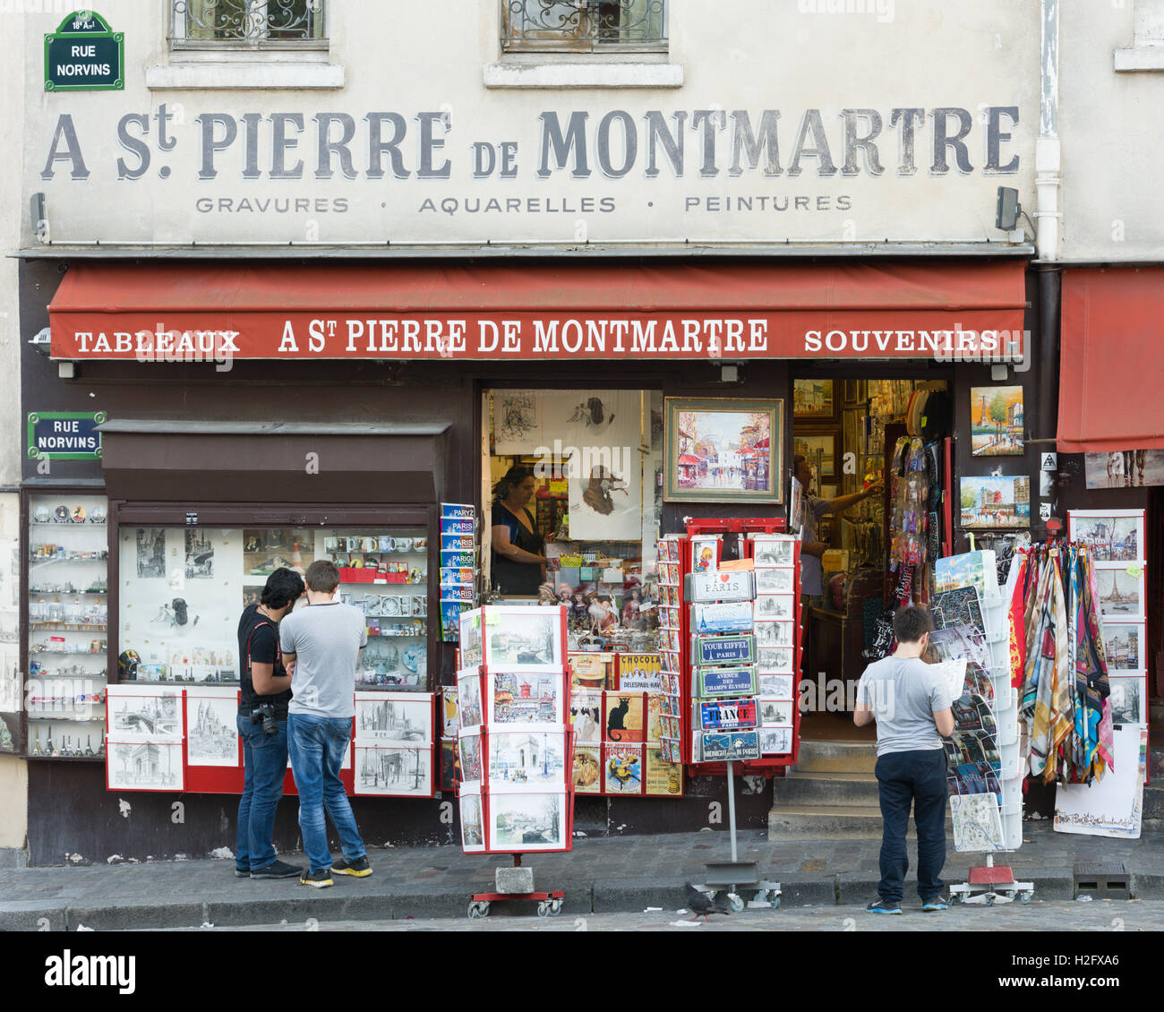 Shop in Montmartre Paris selling photos and postcards for tourists - Stock Image