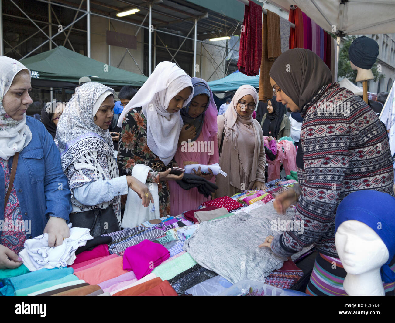 Women shopping for hijabs at street fair at American Muslim Day Parade in New York City, 2016. - Stock Image