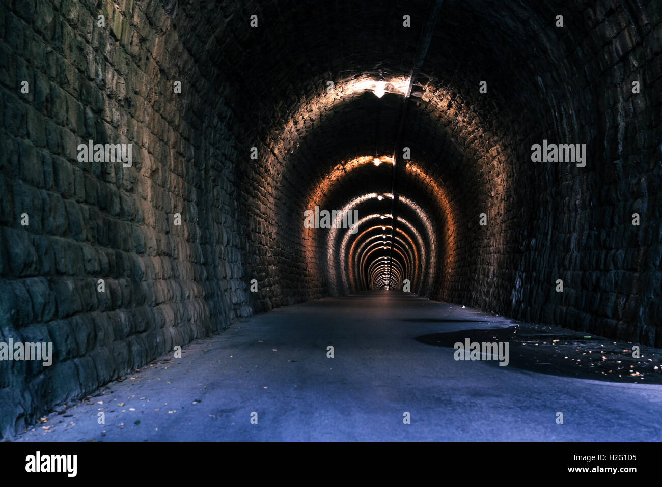Endless tunnel as abstract background with vanishing point perspective - Stock Image