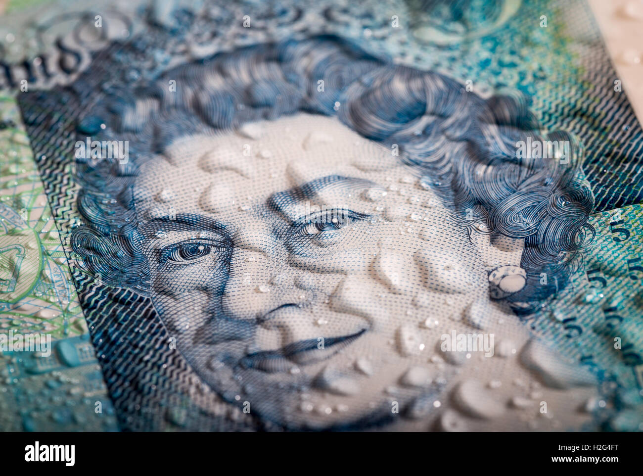 A close up detailed photo of the New waterproof Polymer UK Five Pound Note showing its water resistance Stock Photo