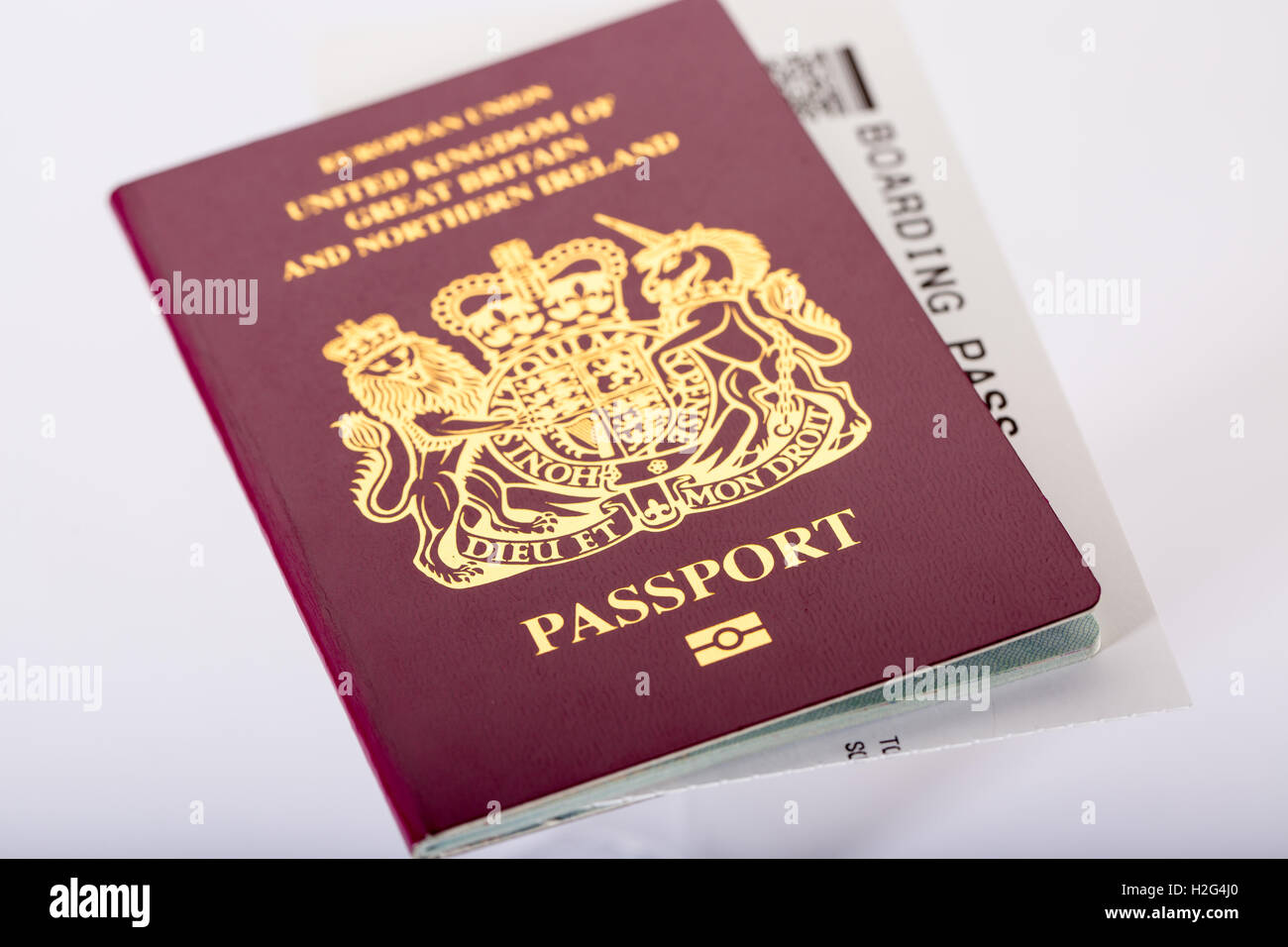 A British UK Passport and plane boarding card - Stock Image