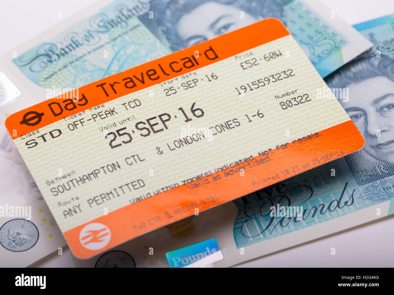 A National Rail train ticket with UK Money - Stock Image