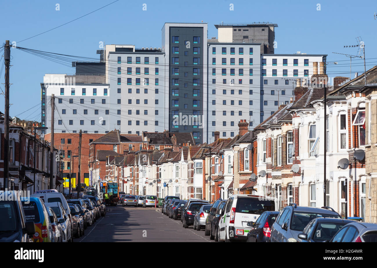 New student accommodation 'Crescent Place' run by The Student Housing Company towering over terrace housing - Stock Image