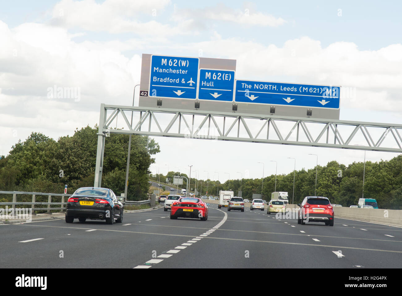 UK motorway signs on overhead gantry - junction 42 of the M1 heading north - Stock Image