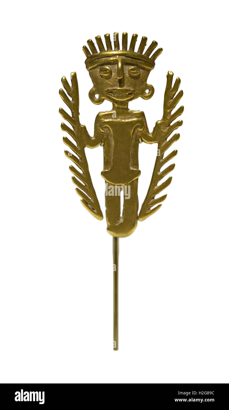 A cast gold pendant from 5th to 10th century from Tolima region of Colombia, figure has feather headdress - Stock Image