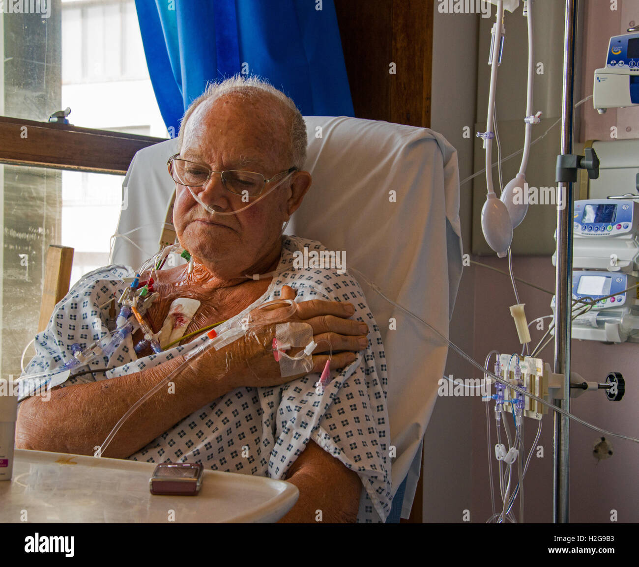 Patient recovering day after heart by-pass surgery. - Stock Image