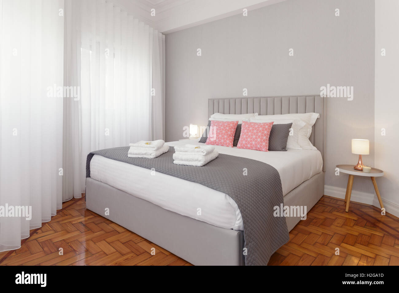 Beautiful and bright bedroom - Stock Image