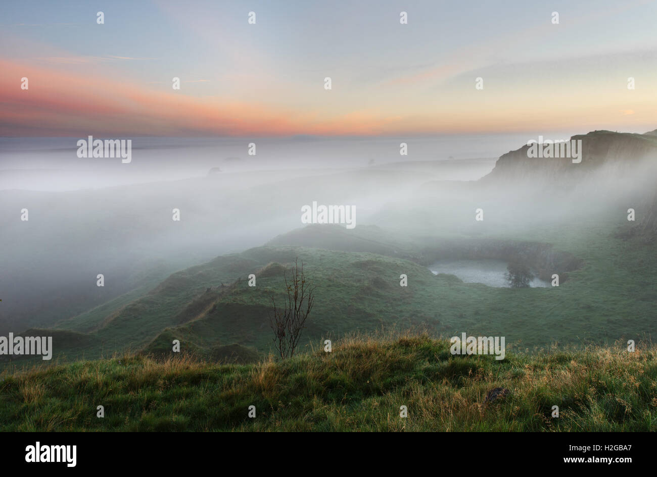 Early morning mist at sunrise, Walltown Crags, Hadrian's Wall - the view looking north-east over the disused - Stock Image
