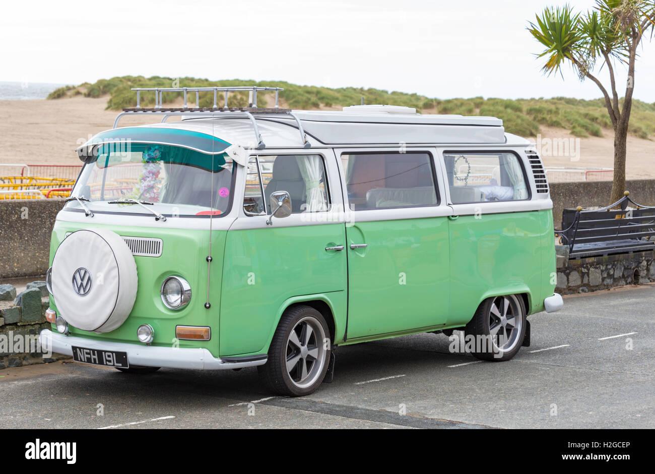Volkswagen campervan at a British seaside resort. - Stock Image