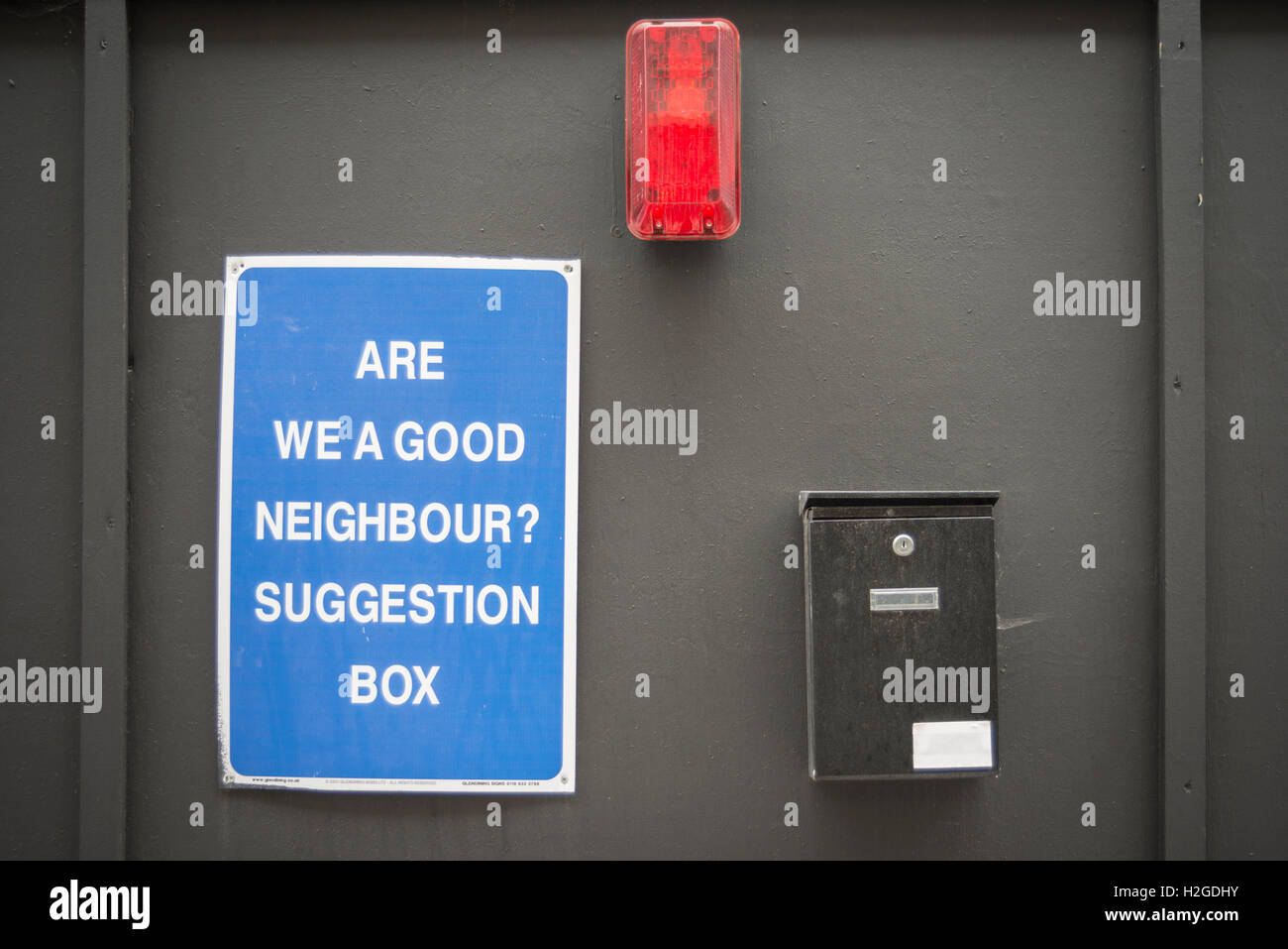 are we a good neighbour? suggestion box on the wall of a building site in London - Stock Image