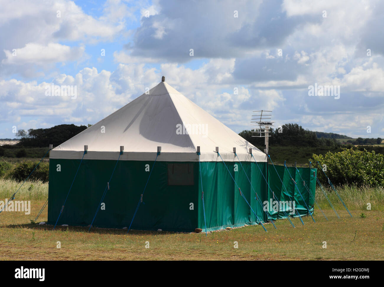 Tent with a television aerial. - Stock Image