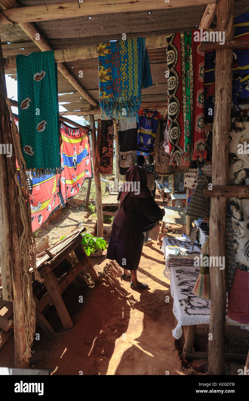 Swazi craft market selling craft, souvenirs and gifts with salesladies and customers, Swaziland - Stock Image