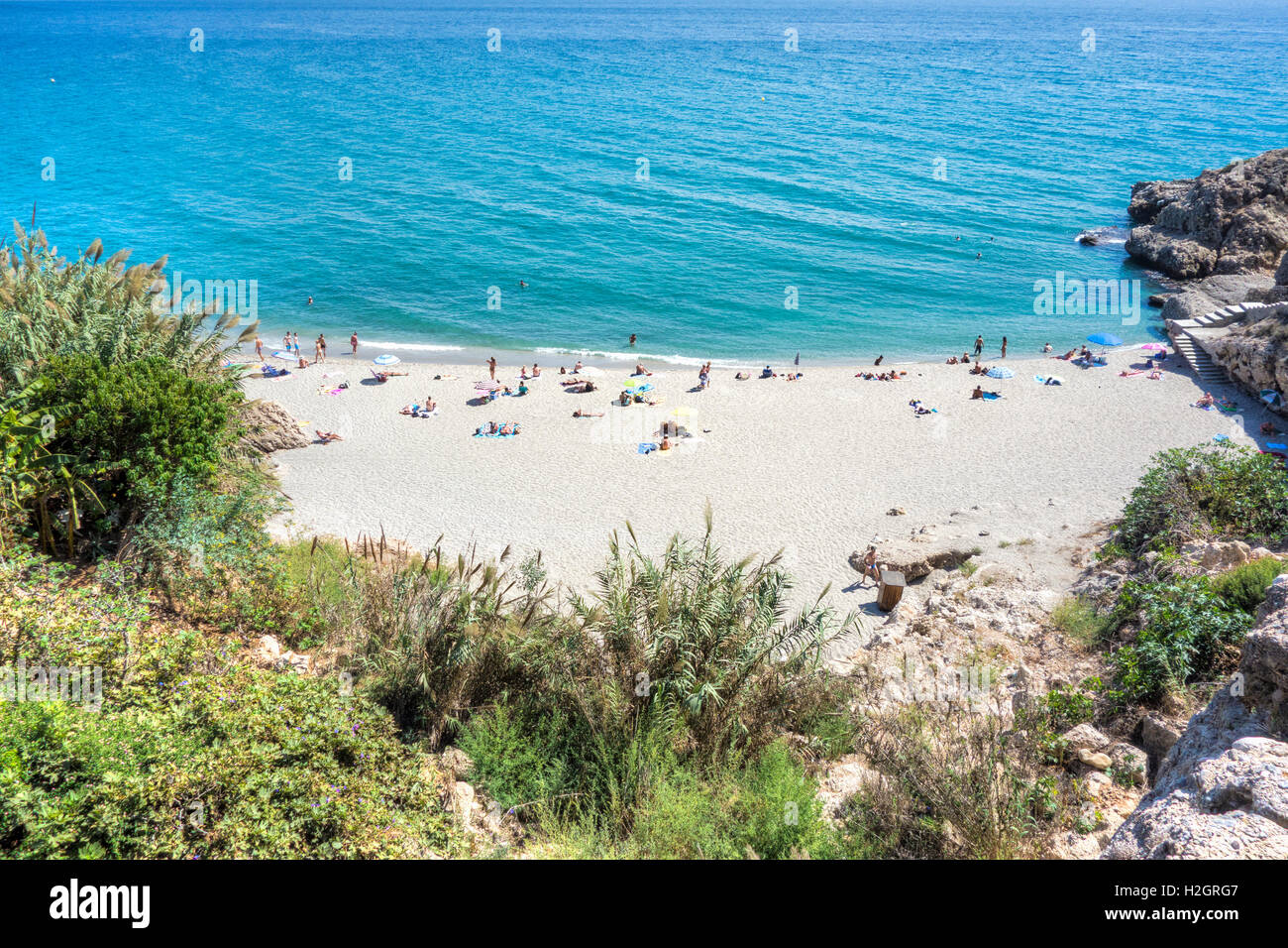 The small beach called Playa Carabeillo in Nerja on the Costa Del Sol Spain - Stock Image