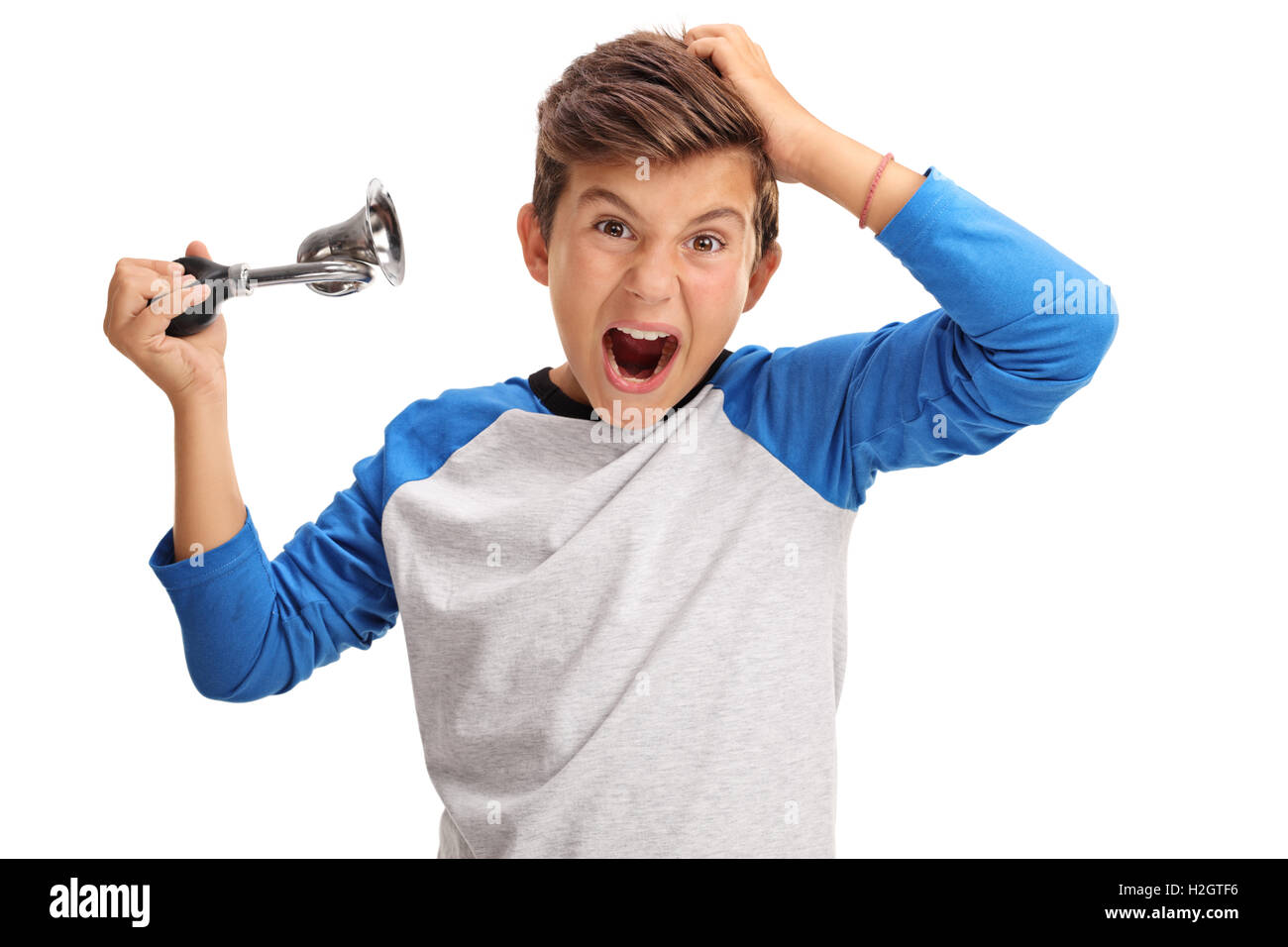 Overjoyed little boy honking a horn isolated on white background - Stock Image