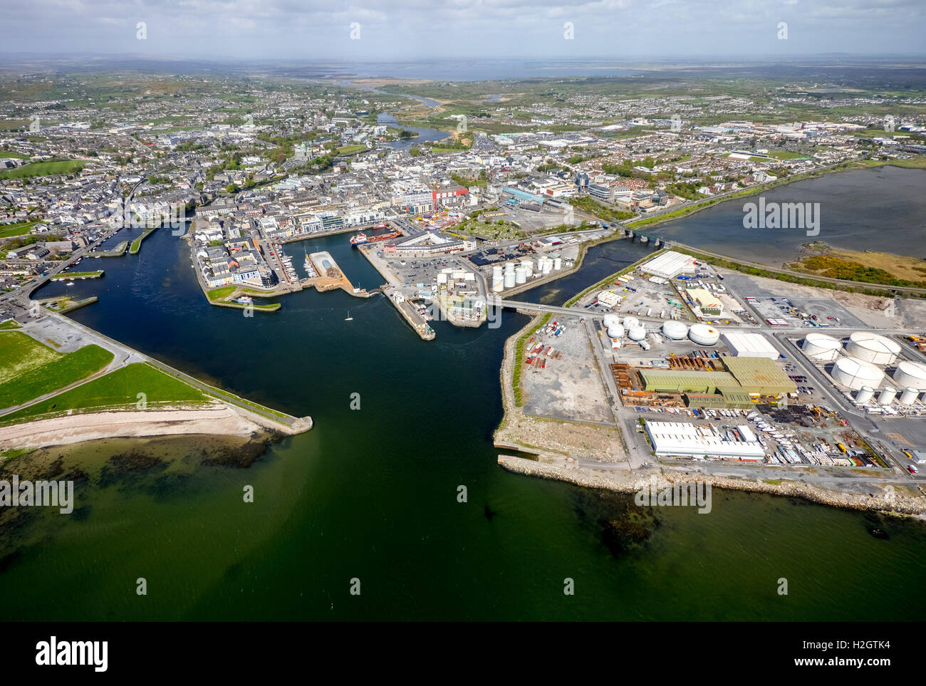 View of town and harbour, docks and Business Enterprise Park, Galway, County Clare, Ireland - Stock Image