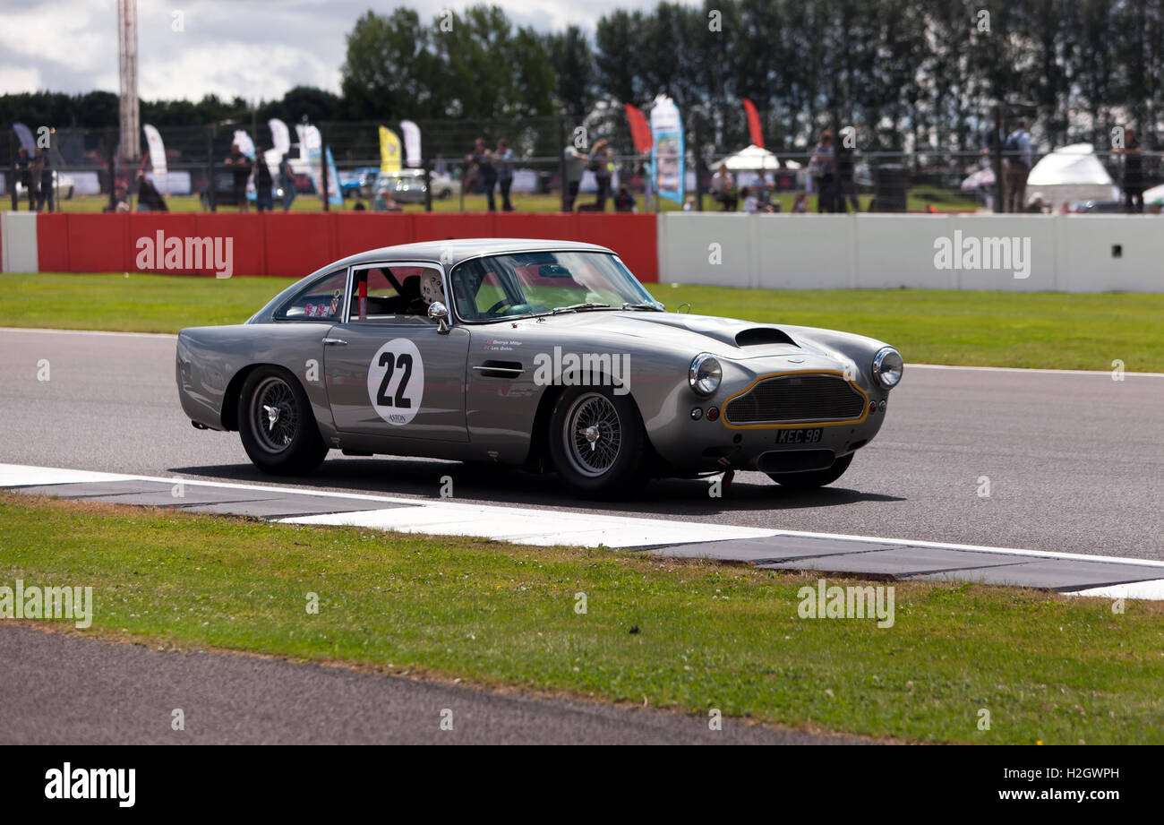 George Miller driving a1961 Aston Martin DB4 during the qualifying session for the RAC Tourist Trophy for Pre 63' - Stock Image