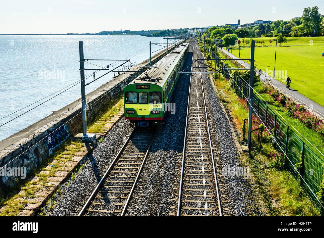 Commuter train between Booterstown and Blackrock Dublin Ireland - Stock Image