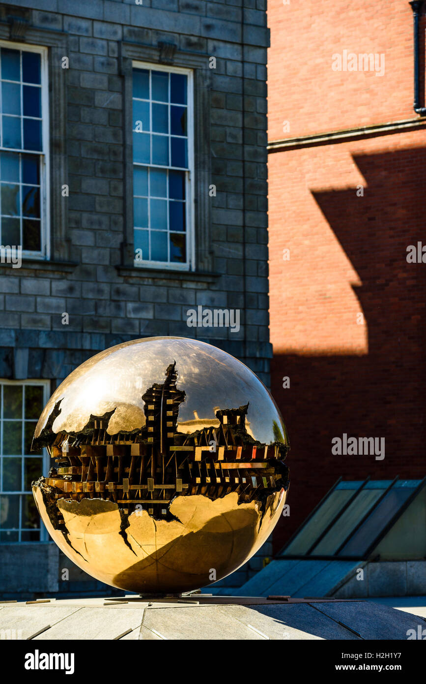 Sphere Within Sphere (Sfera con sfera) sculpture by Arnaldo Pomodoro, Trinity College Dublin, Ireland - Stock Image