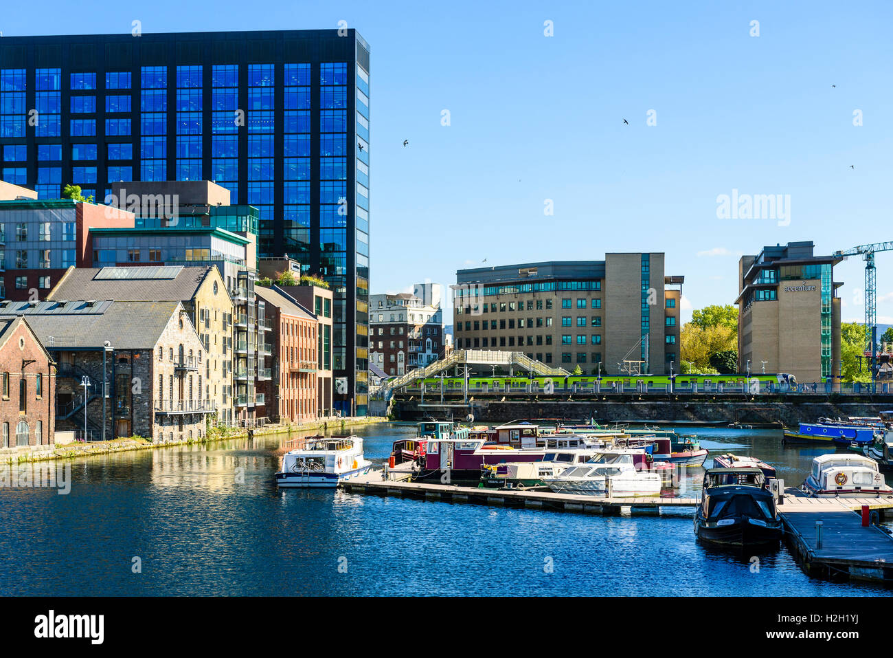 Grand Canal Dock Dublin with the boat collection of the Waterways Ireland Visitor Centre - Stock Image