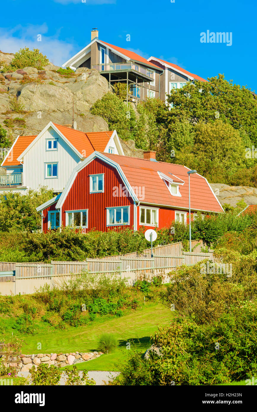 Orust, Sweden - September 9, 2016: Environmental documentary of hillside homes with rocky landscape and nature just Stock Photo