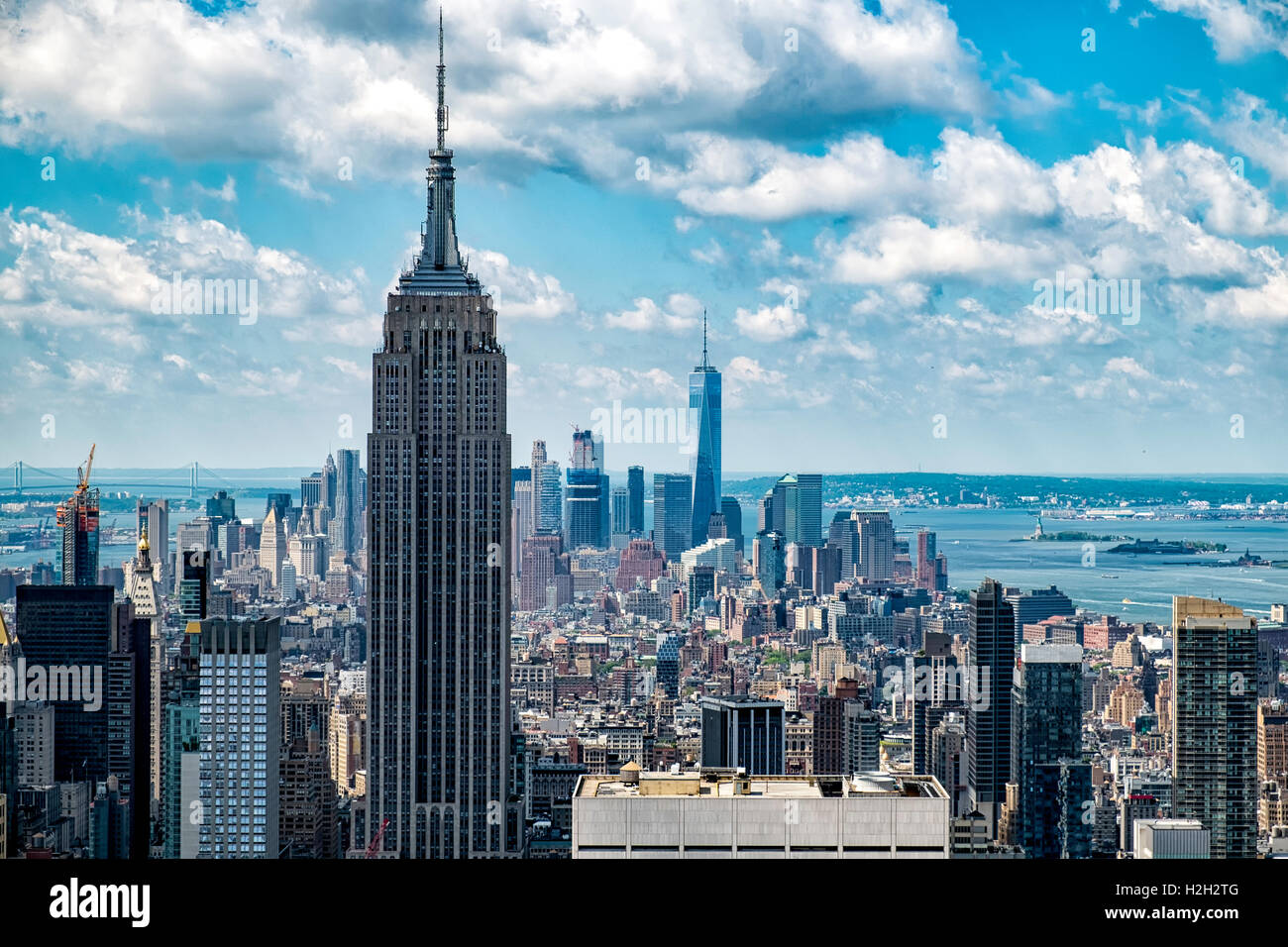 Overview of Manhattan New York city, empire state in the forefront with the rest of manhattan behind on a partially - Stock Image