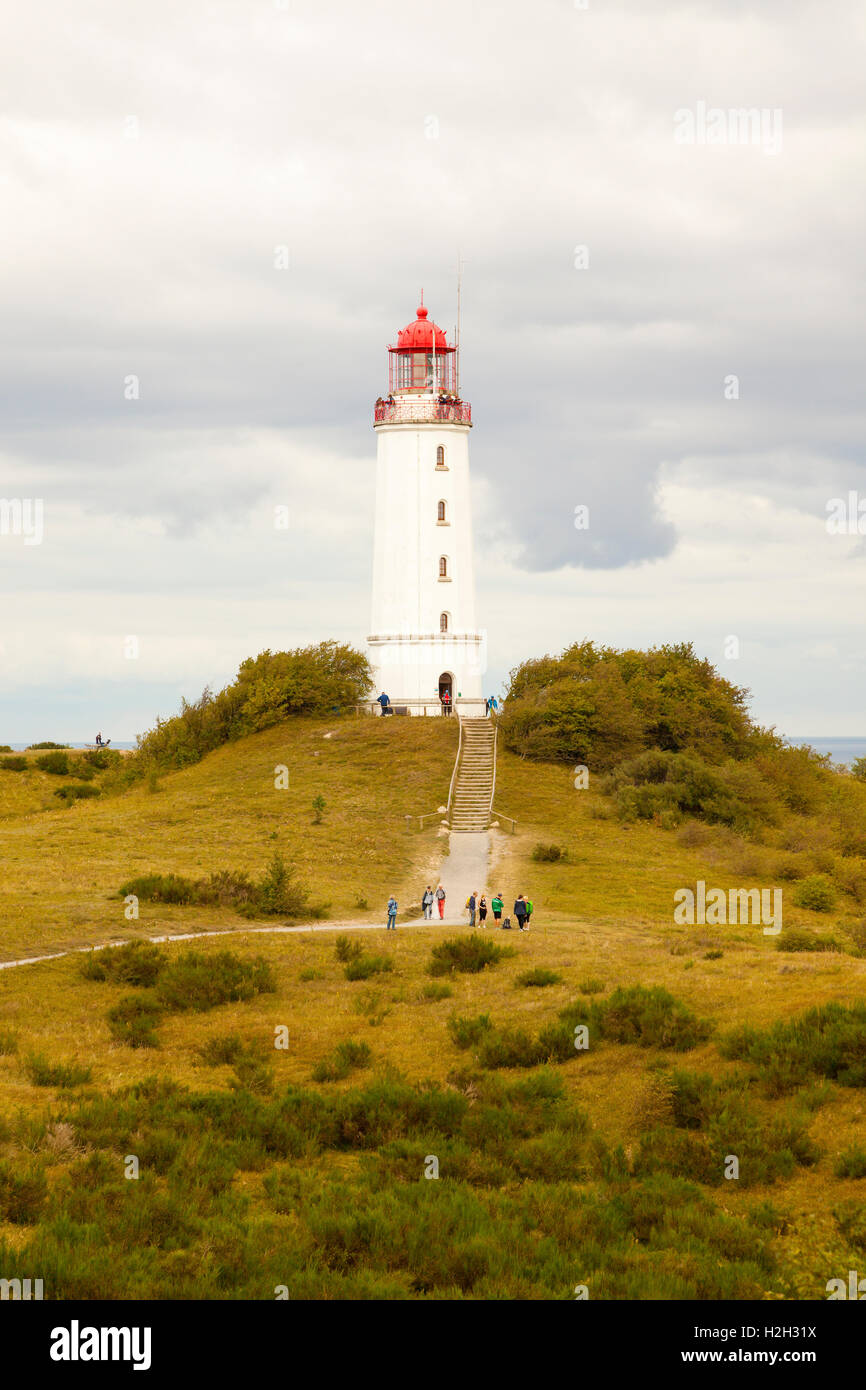 Tourist visiting Dornbusch lighthouse on Hiddensee island in the Baltic Sea, Germany - Stock Image
