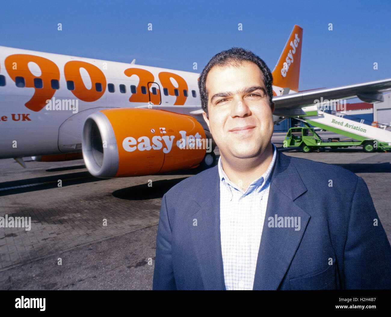 easyJet founder Stelios Haji-Ioannou in front of one of his planes at Luton Airport, UK - Stock Image