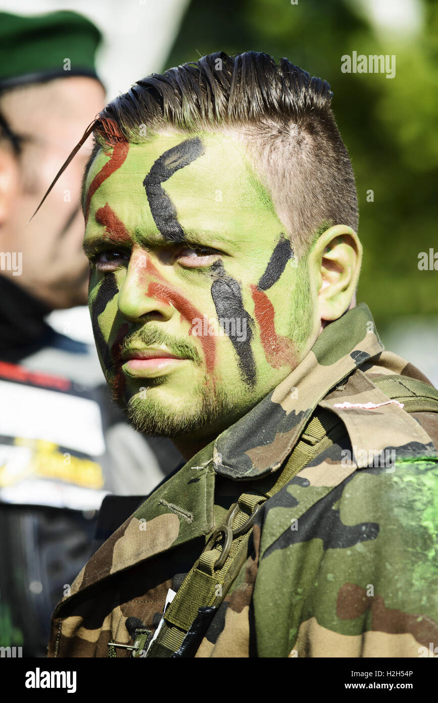 LYON, FRANCE - MAY 24: A man dressed in military commando,  Frappadingue race participating in the event in the - Stock Image