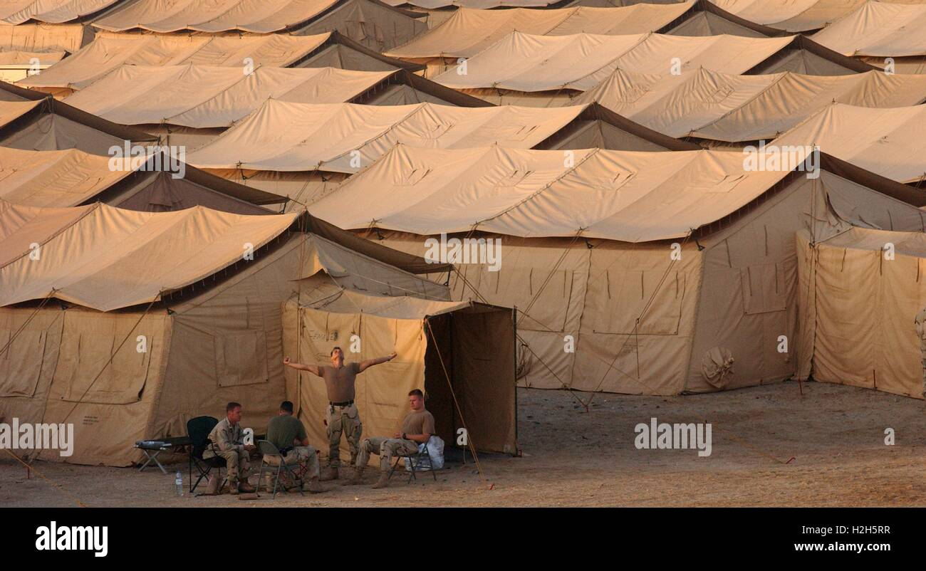 U.S. Air Force soldiers sit outside Tent City a base made up of hundreds of tents that will house U.S. soldiers deployed in support of Operating Enduring ... & U.S. Air Force soldiers sit outside Tent City a base made up of ...
