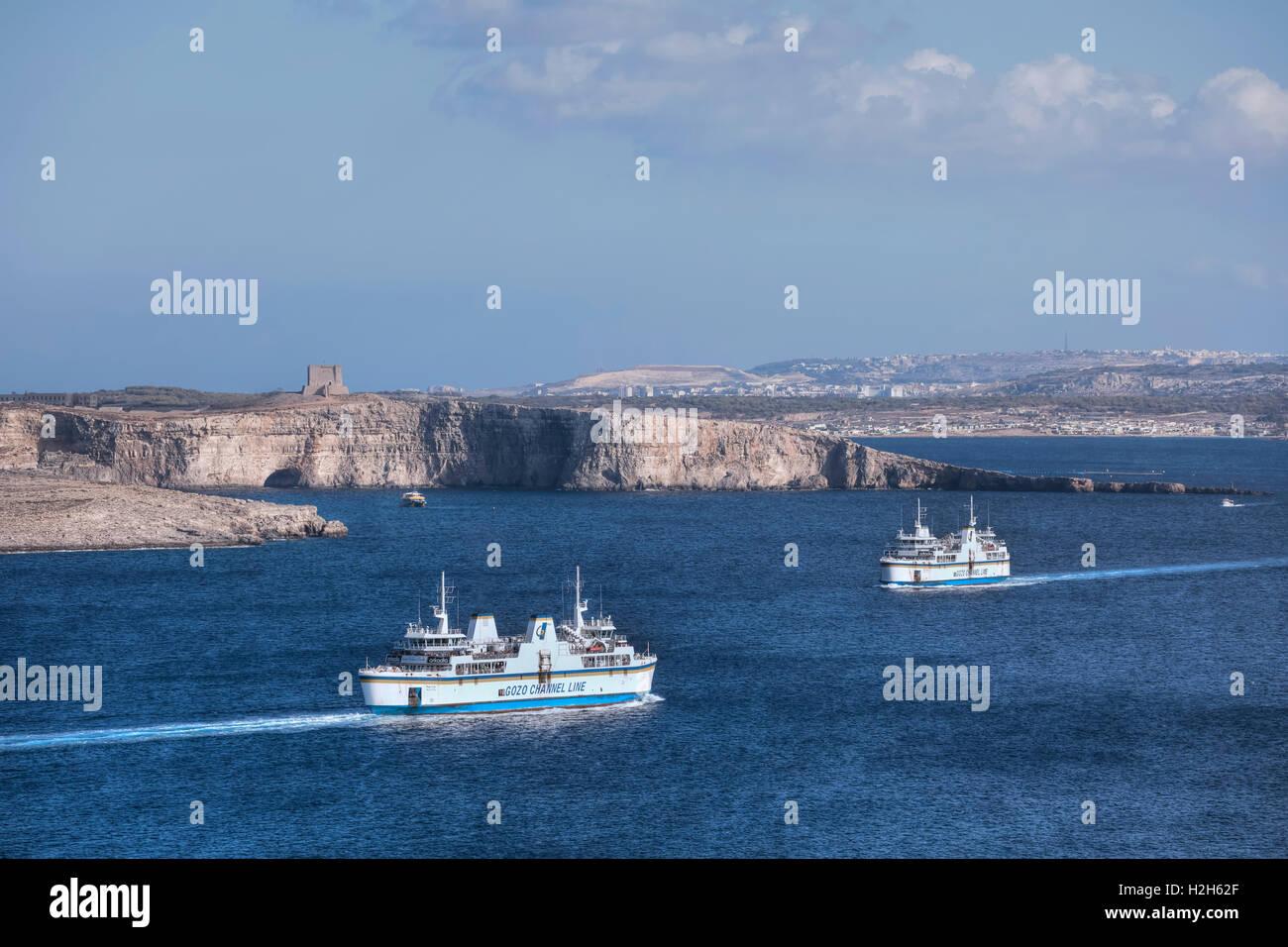 Gozo ferries with view to Comino, Malta - Stock Image