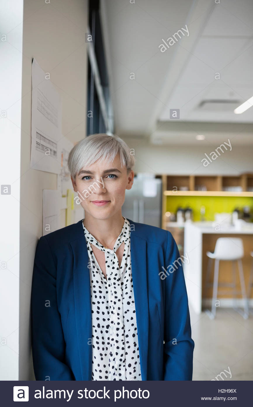 Portrait confident female architect in office - Stock Image