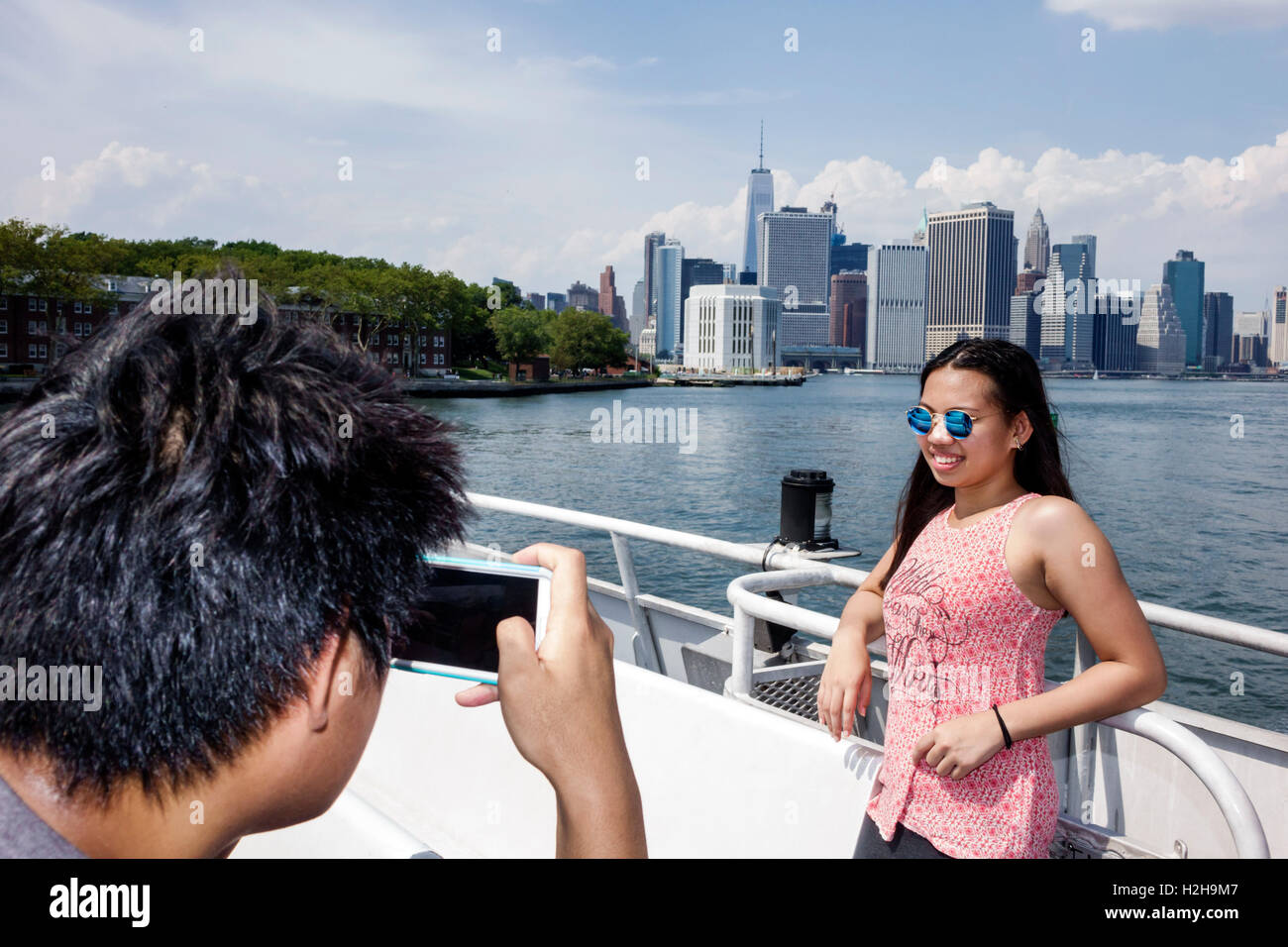Brooklyn New York City NYC NY New York Harbor Brooklyn Bridge Park Pier 6  Governors Island Ferry boat passenger Manhattan skyline Asian girl boy teen