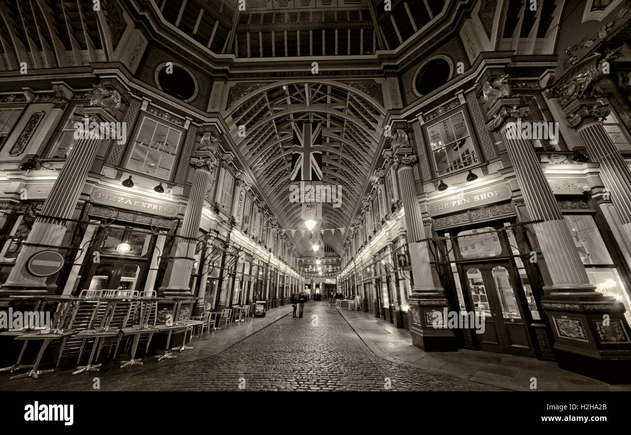 Leadenhall market at night,City Of London,England,UK - Panorama with Union Flag B/W - Stock Image