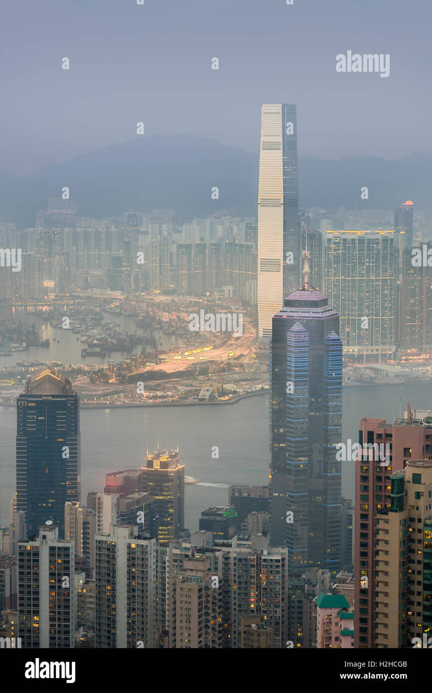 View over Hong Kong from Victoria Peak, ICC and the skyline of Central sits below The Peak at dusk, Hong Kong, China Stock Photo