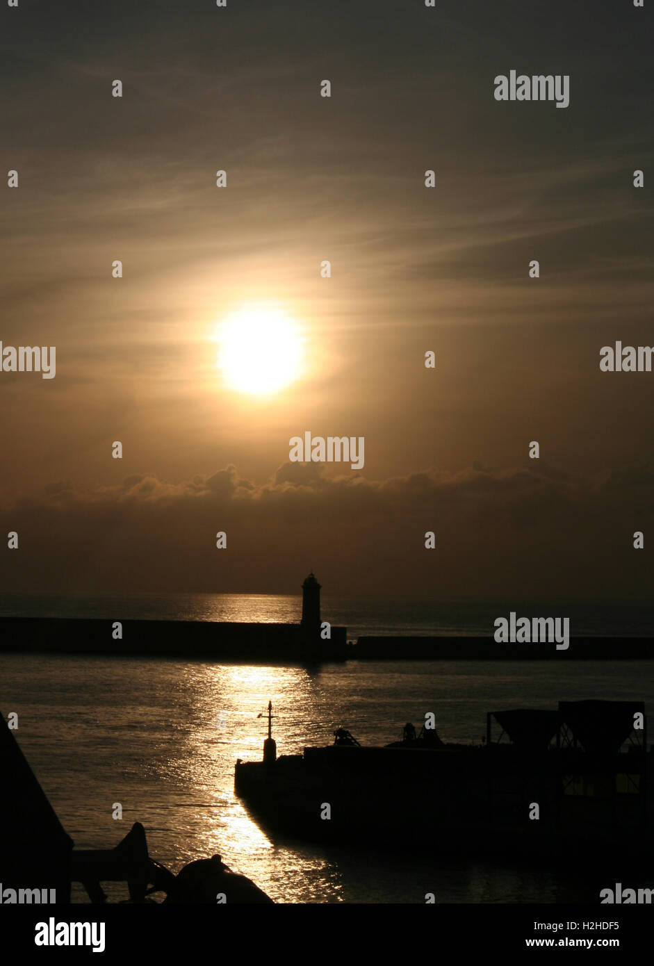 Sunset and silhouette in Livorno - Stock Image