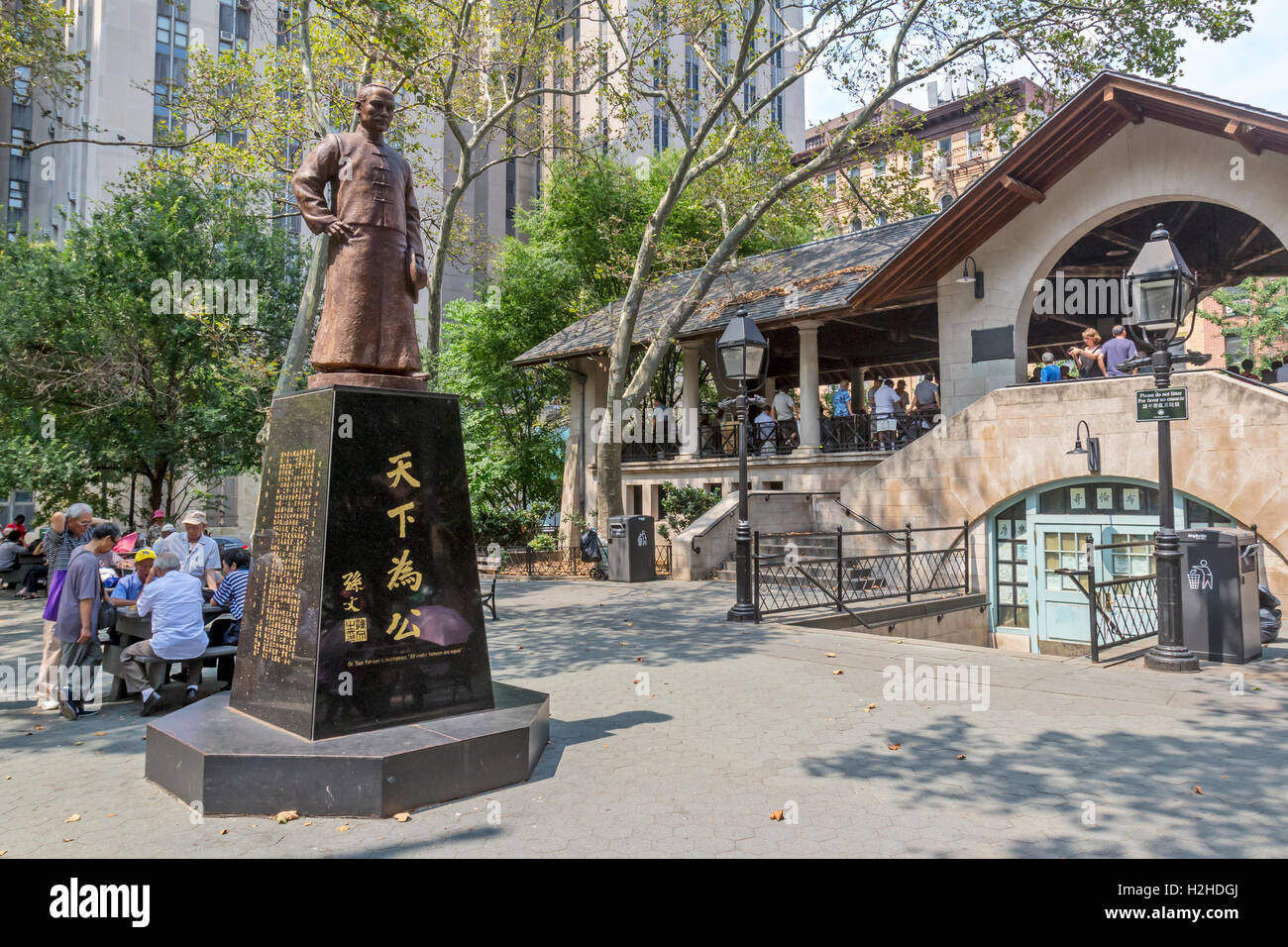 Families of  Chinese Americans in Columbus Park in Chinatown, New York City playing Chinese Chess, also known as, - Stock Image