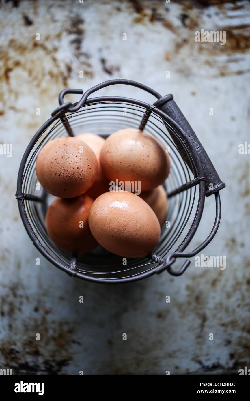 Basket with fresh eggs Stock Photo