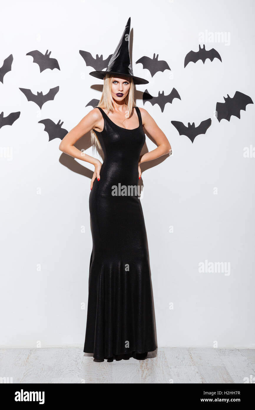 Full length of attractive young woman in black witch costume with hat standing over white background  sc 1 st  Alamy & Teen Witch Costume Stock Photos u0026 Teen Witch Costume Stock Images ...