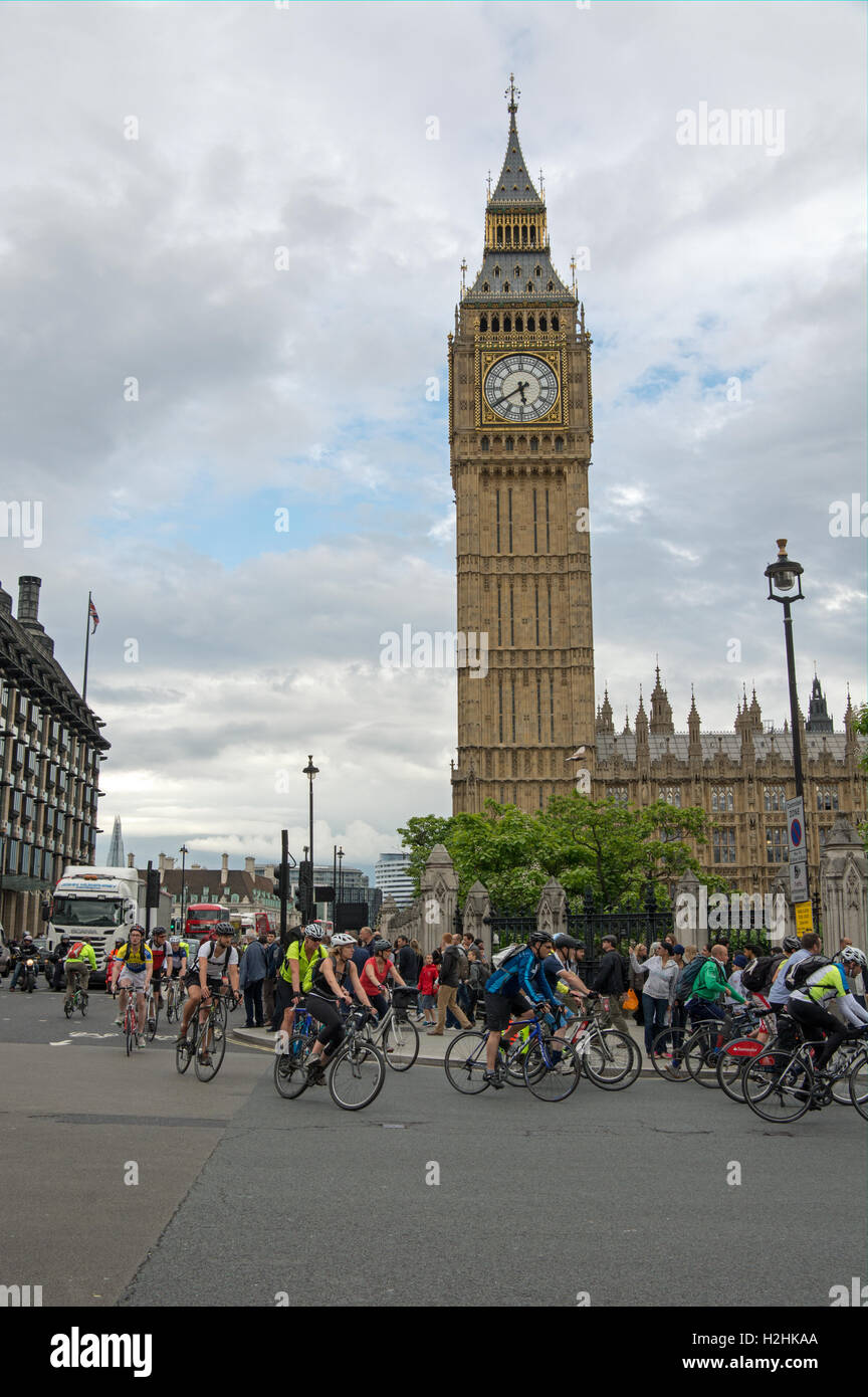Cyclist head for home entering parliament Square from Westminster Bridge. - Stock Image