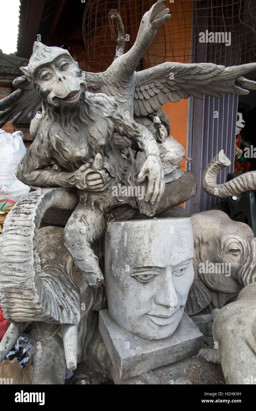 Indonesia, Bali, Ubud, Jalan Raya Peliatan, sculptures on display outside commercial art workshop - Stock Image