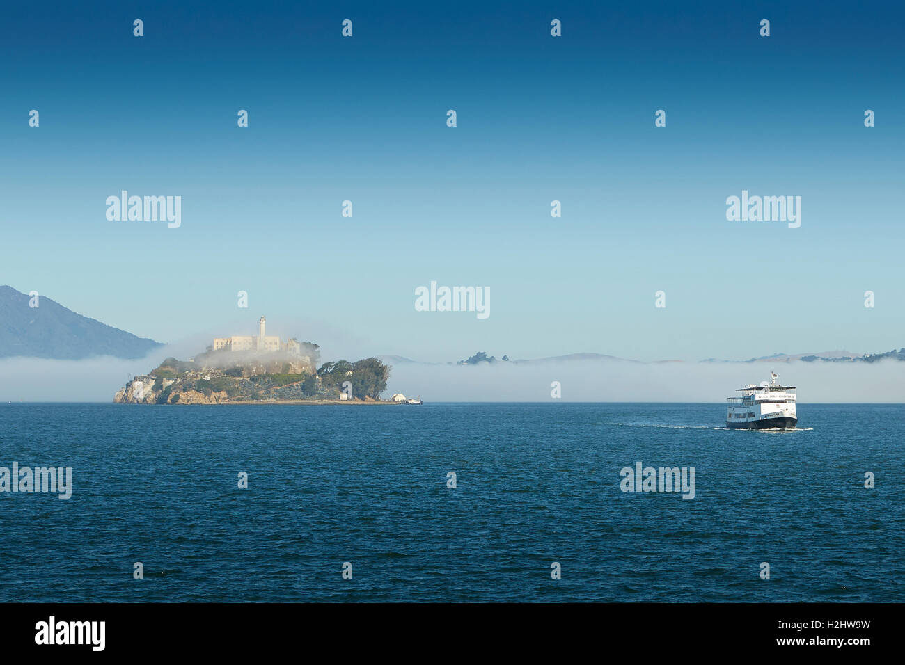 Early Morning Image Of Alcatraz, Sea Fog Rolling Over The Island. - Stock Image