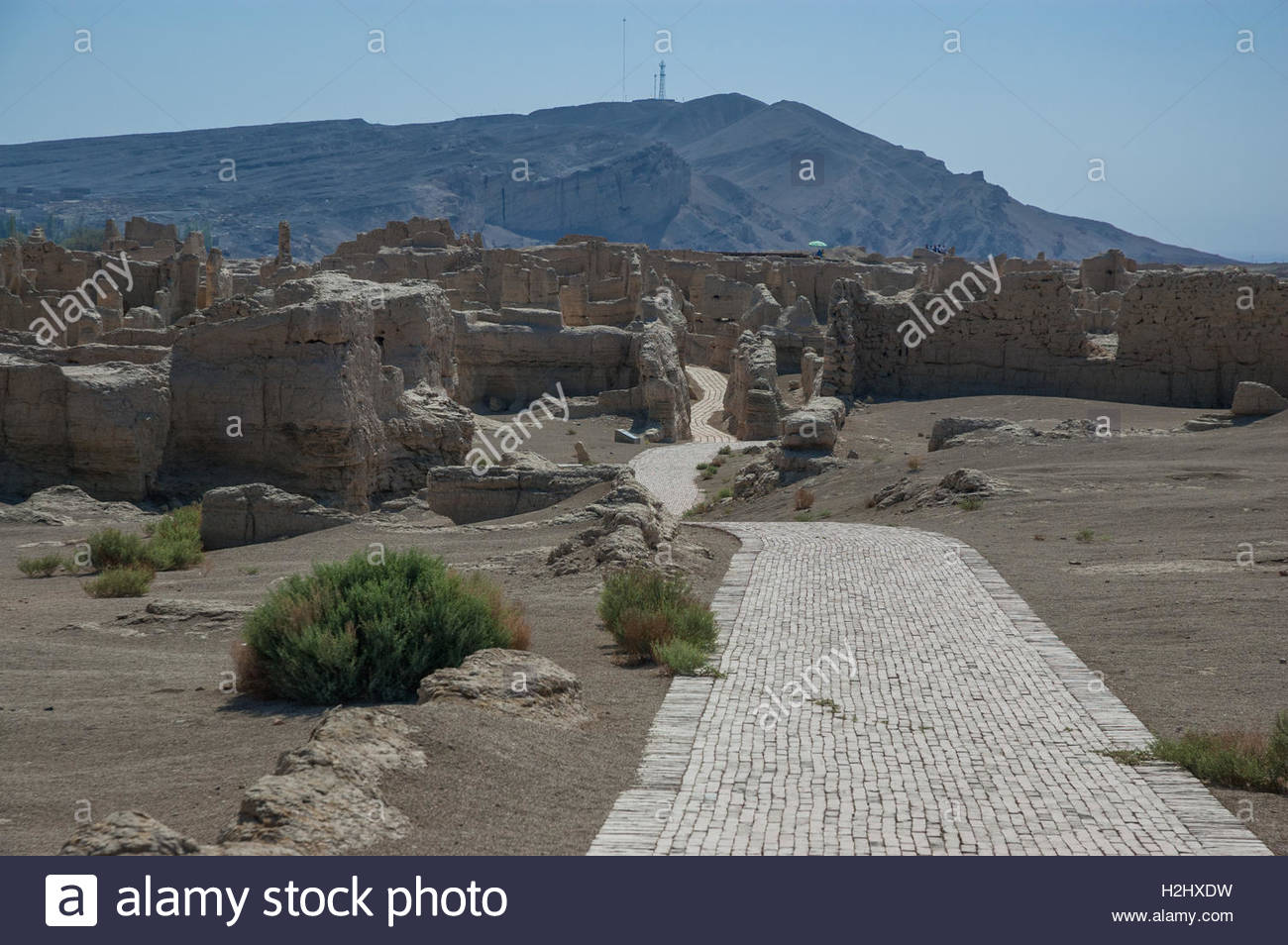 Ruins in the ancient city of Jiaohe a former Han garrison town near Turpan in the desert, Xinjiang Province, China - Stock Image