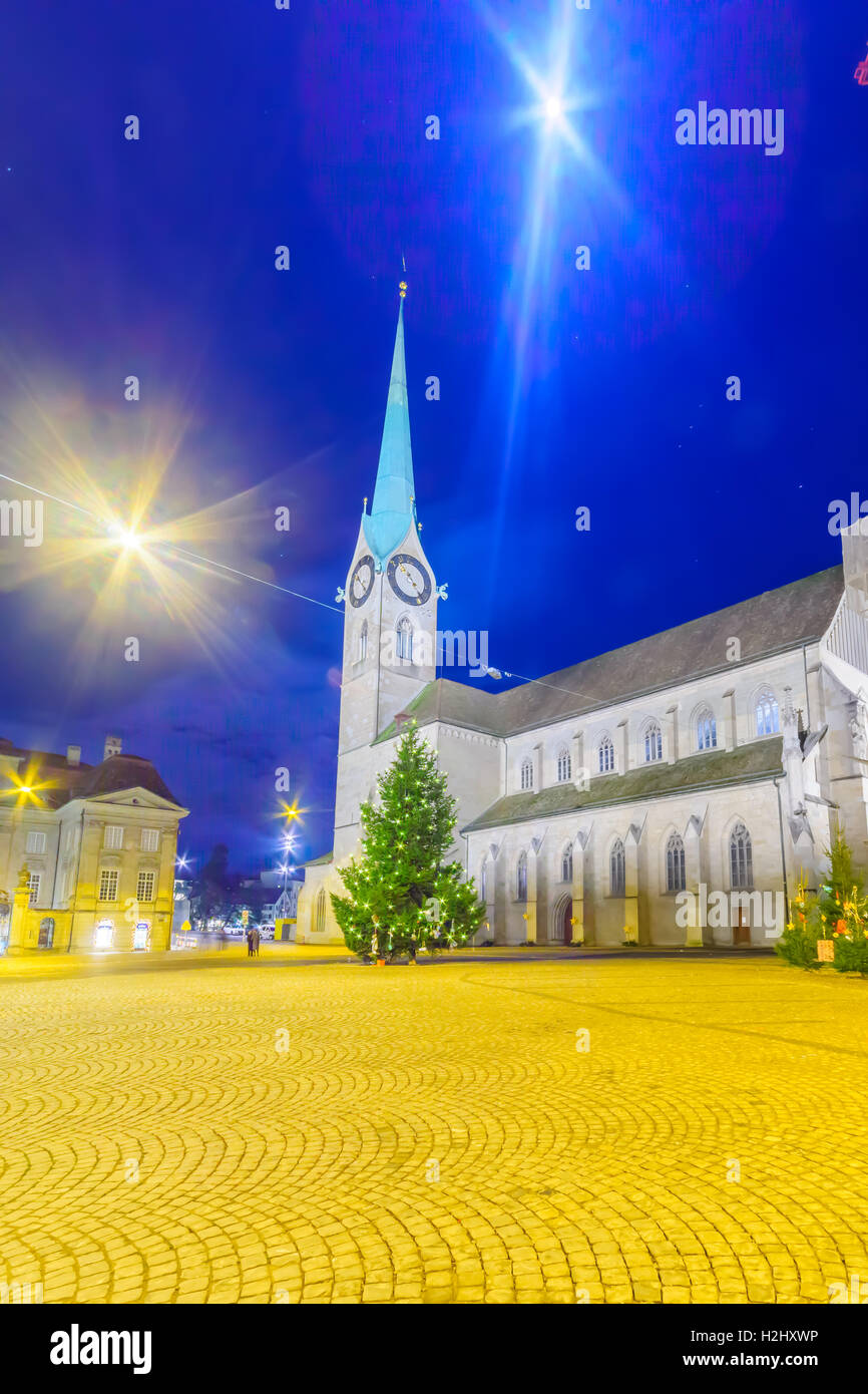 The Fraumunster (Women Minster) Church at night, with Christmas trees, in Zurich, Switzerland - Stock Image