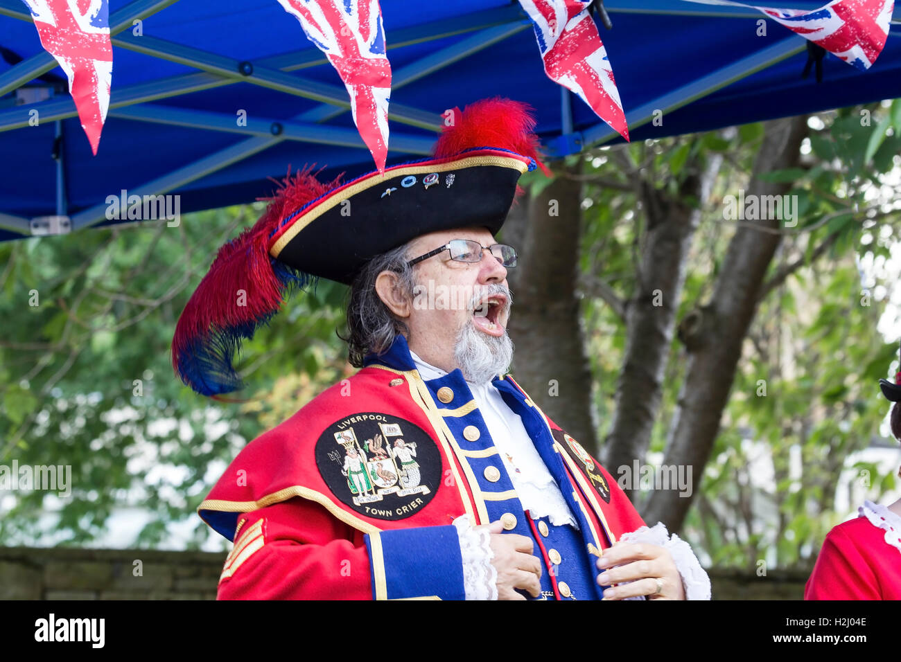 The Liverpool Town Crier loudly proclaiming a message at the Huddersfield Town Crier's competition 2016 - Stock Image
