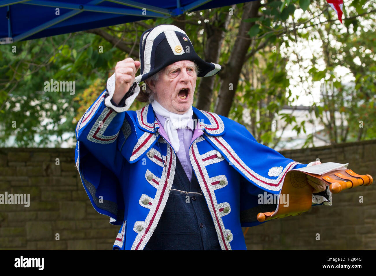 A Town Crier loudly proclaiming a message at the annual Huddersfield Town Crier's competition 2016 - Stock Image